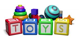 "Illustration of children's toys and toy blocks spelling the word ""Toys"""